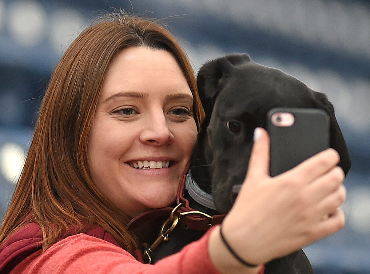 Keeley Fitzgerald of Binghamton takes a selfie with her dog Misha during Mutt Monday as the Binghamton Rumble Ponies hosted the Akron RubberDucks at NYSEG Stadium, April 29, 2019.