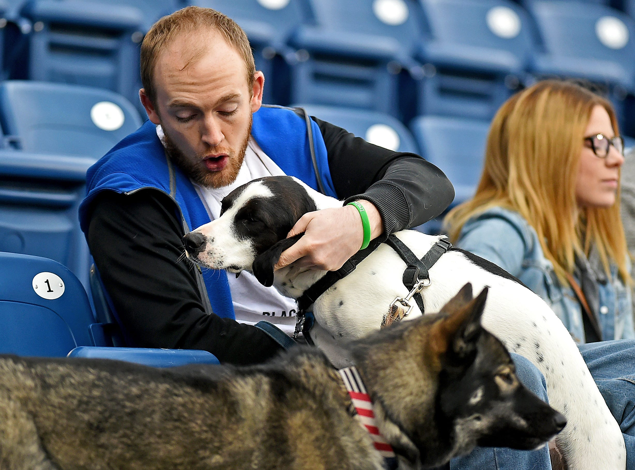 Ryan Connelly with dogs Duke and Mercedes during Mutt Monday as the Binghamton Rumble Ponies hosted the Akron RubberDucks at NYSEG Stadium, April 29, 2019.
