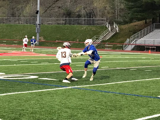 Chenango Valley's Shane Ladd (13) is defended by Owego's Ben Miller in the first half of Monday's Section 4 Conference game at CV. Owego won, 7-4.