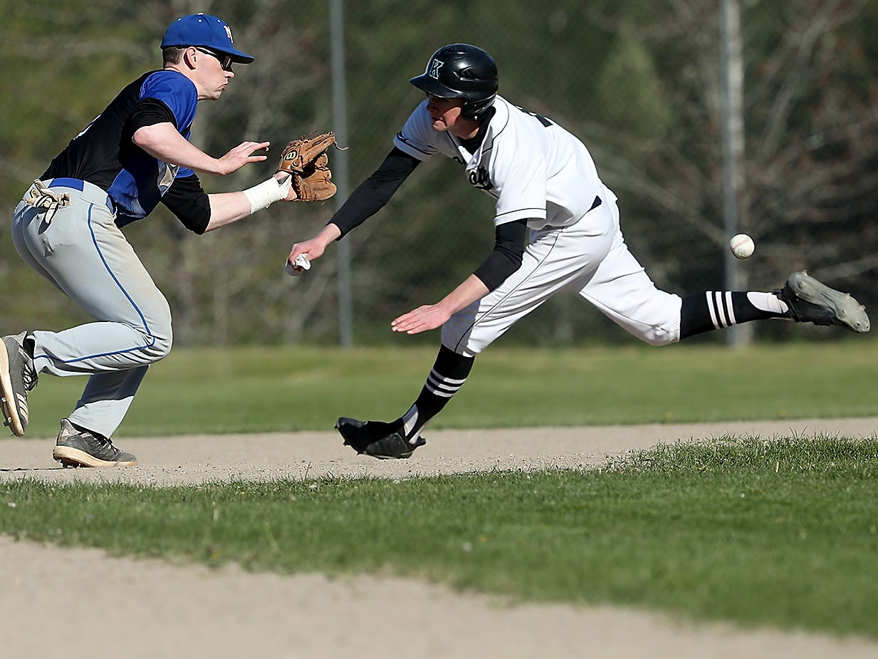 Klahowya's Logan Prater gets ready to slide to second as he beats the throw to North Mason's Brenden Kimball at Klahowya on Monday, April 29, 2019.