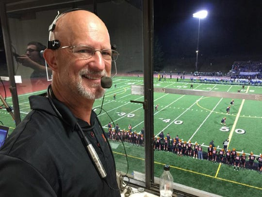 Paul Stensen in the pressbox at Silverdale Stadium, where he's called Central Kitsap football games for decades.