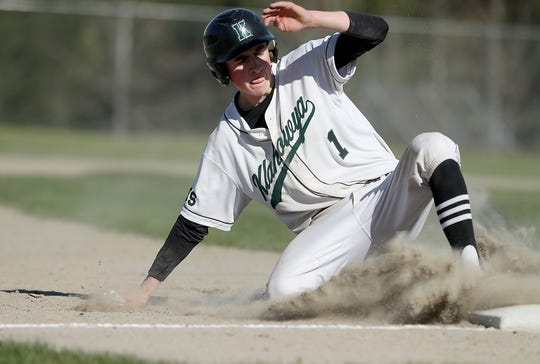 Klahowya's Logan Prater slides safely into third base against North Mason on Monday, April 29, 2019.