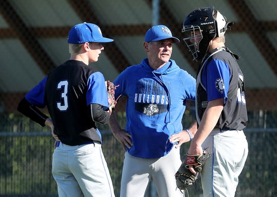 North Mason head coach Bill Geyer talks with pitcher 	Mason Fisher and catcher Mason Shumaker at the mound during their game against Klahowya on Monday, April 29, 2019.
