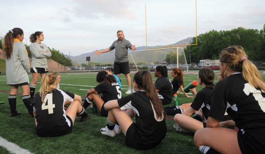 Owen soccer head coach David Fiest talks to his players before a 3-0 victory over Madison on April 29. The head coach of both the Warhorses and Warlassies soccer teams has won 40 straight Western Highlands Conference games over the past two years.