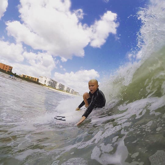 Indialantic's Beckham McCart, 10, rides a big wave in Puerto Rico. He and twin sister, Daya, are off to a great start on the amateur surfing circuit.