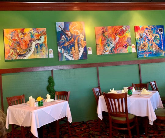 Colorful art hangs on the walls at Heidelberg Restaurant in downtown Cocoa Beach.