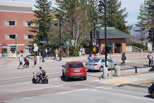 Pedestrians and motorists jockey for right-of-way at Main Street and University Heights in Burlington on April 23, 2019.