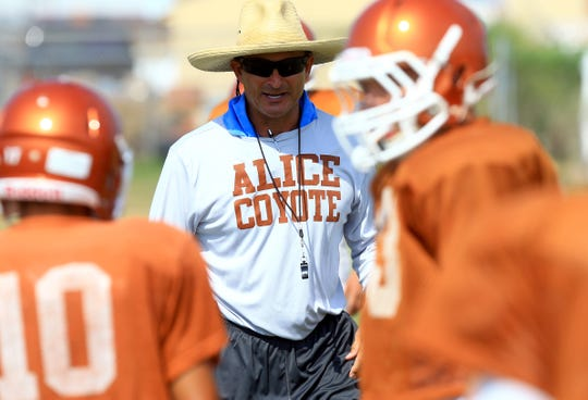 Alice's head coach Chris Soza watches his players run through drills during practice Wednesday, Aug. 12, 2015, at Alice High School in Alice.