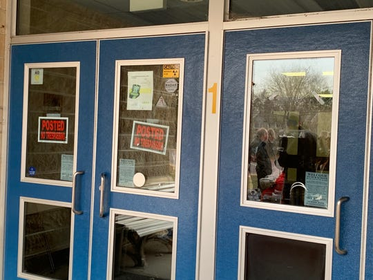 The front doors of Holly Glen School in Williamstown were posted to warn trespassers March 18, 2019. The school has been closed for two years while a major mold clean-up took place.