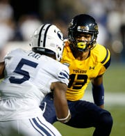 Toledo cornerback Ka'dar Hollman, a Burlington Township graduate, defnds a BYU player during the 2016 season.