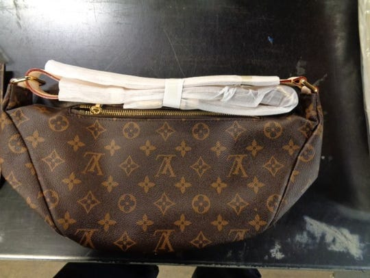 This fake Louis Vuitton purse is among nearly $8 million worth of fake high-end merchandise seized over three days by federal authorities at a local shipping hub.
