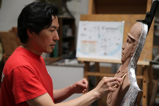 Created by designer Tom Tsuchiya, seen here touching up a clay bust of George Wright, Wednesday, April 24, 2019, the 1869 Pavilion will be dedicated on May 4, the 150th anniversary of the 1869 Red Stockings' first game. It features the original 1869 Red Stockings players and will be the primary memorial to the original team.