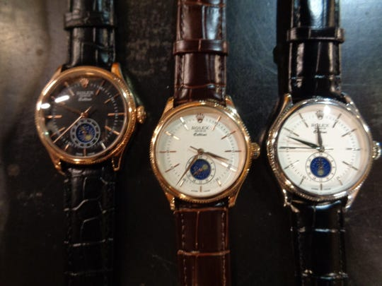 These fake watches are among nearly $8 million worth of fake high-end merchandise seized over three days by federal authorities at a local shipping hub.