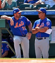 Mar 12, 2019; Jupiter, FL, USA; New York Mets manager Mickey Callaway (left) talks with Mets bench coach Jim Riggleman (right) prior to their spring training game against the Miami Marlins at Roger Dean Chevrolet Stadium. Mandatory Credit: Steve Mitchell-USA TODAY Sports