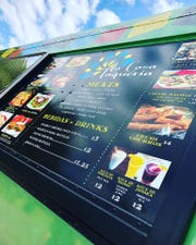 The menu for La Casa Taqueria's food truck.