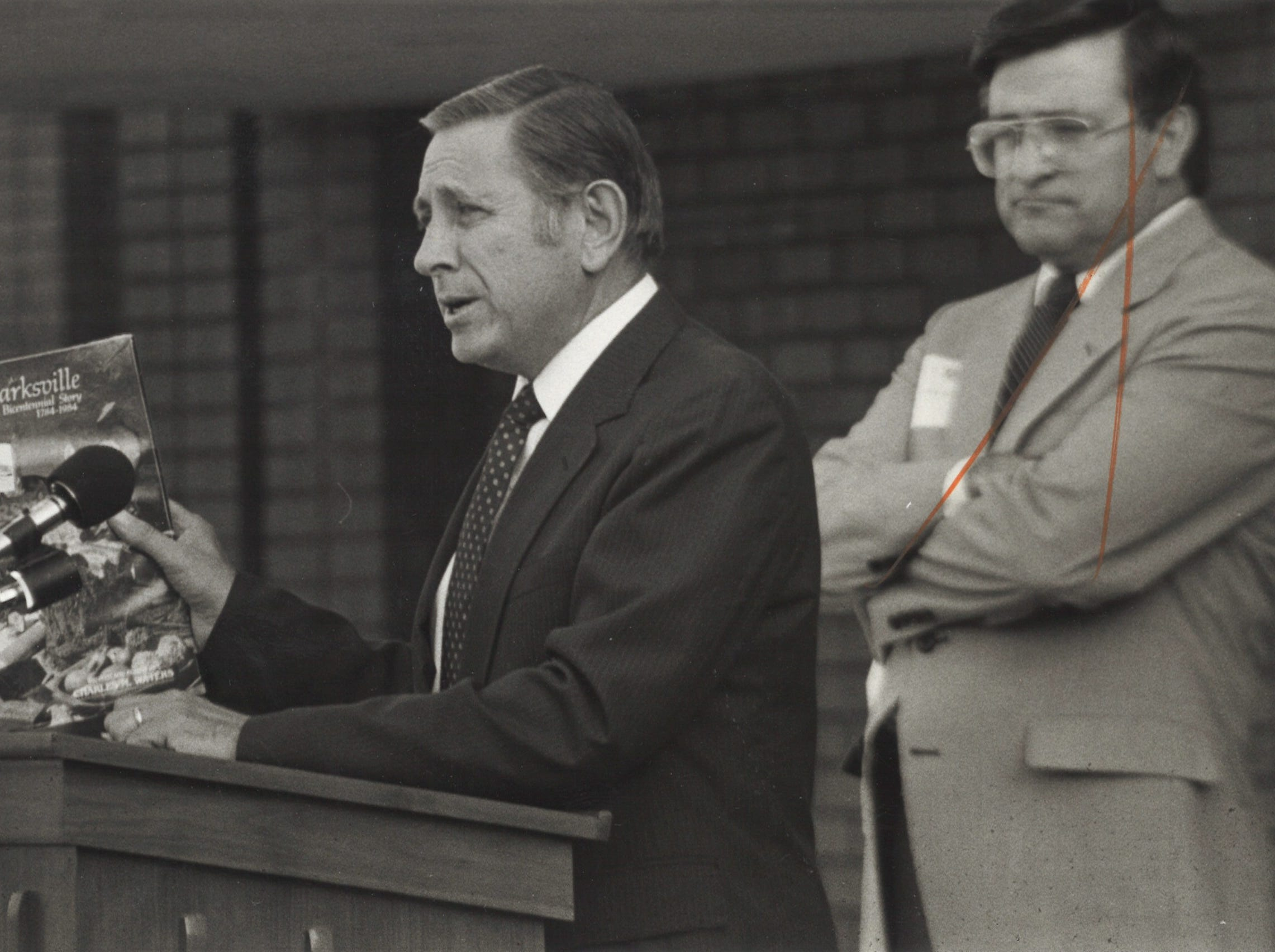 """John Laida, left, with James Cotham III with a copy of """"Historic Clarksville,"""" to be placed in a time capsule in 1983."""