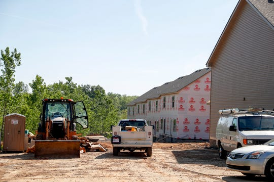 Construction work can be seen at the 1500 block of Wilma Rudolph Blvd. in Clarksville, Tenn., on Monday, April 29, 2019. It's an example of the infill development that planners said is needed to accommodate growth without adding to sprawl.