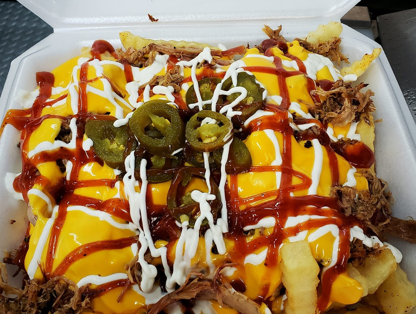 The loaded fries at Gray Smoke Barbecue.