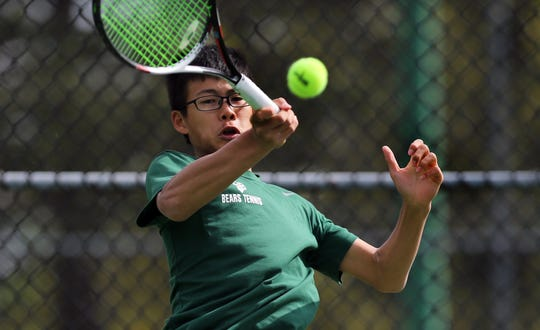 Jack Wong of East Brunswick competes in the first singles final of the Greater Middlesex Conference Tournament Monday