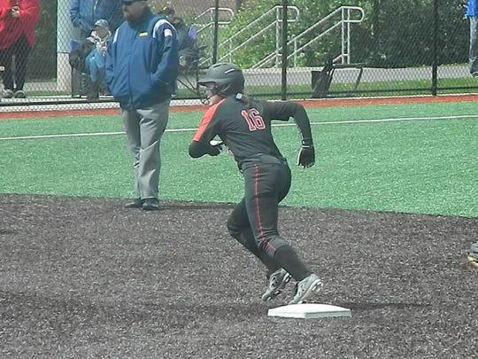 Woodbridge's Emelia Kraft leads off second base against Dunellen on Saturday, April 27, 2019.