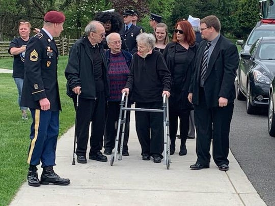 The family of U.S. Army Sgt. Frank J. Suliman who died as a prisoner-of-war during the Korean War, attend his funeral