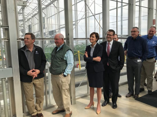 U.S. Agriculture Secretary Sonny Perdue gets a look at Corteva Agriscience greenhouse, along Corteva CEO Jim Collins, Gov. Kim Reynolds and Lt. Gov. Adam Gregg.