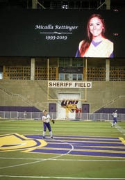 A memorial to former UNI softball player Micalla Rettinger shows over the UNI-Dome field in Cedar Falls on Tuesday, April 29, 2019.