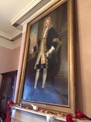 A portrait hangs above a fireplace mantel at the Commandant's Quarters in Dearborn, now the city's historical museum.