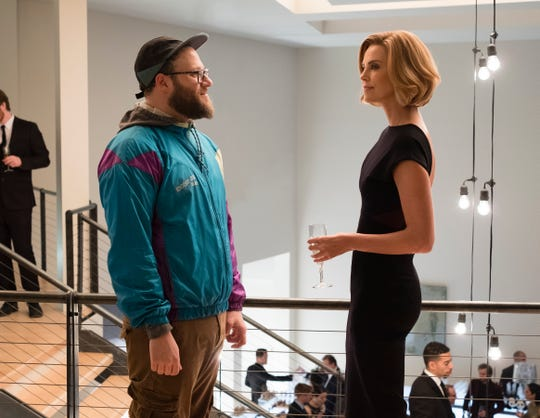 "Seth Rogen, left, and Charlize Theron in  ""Long Shot."""