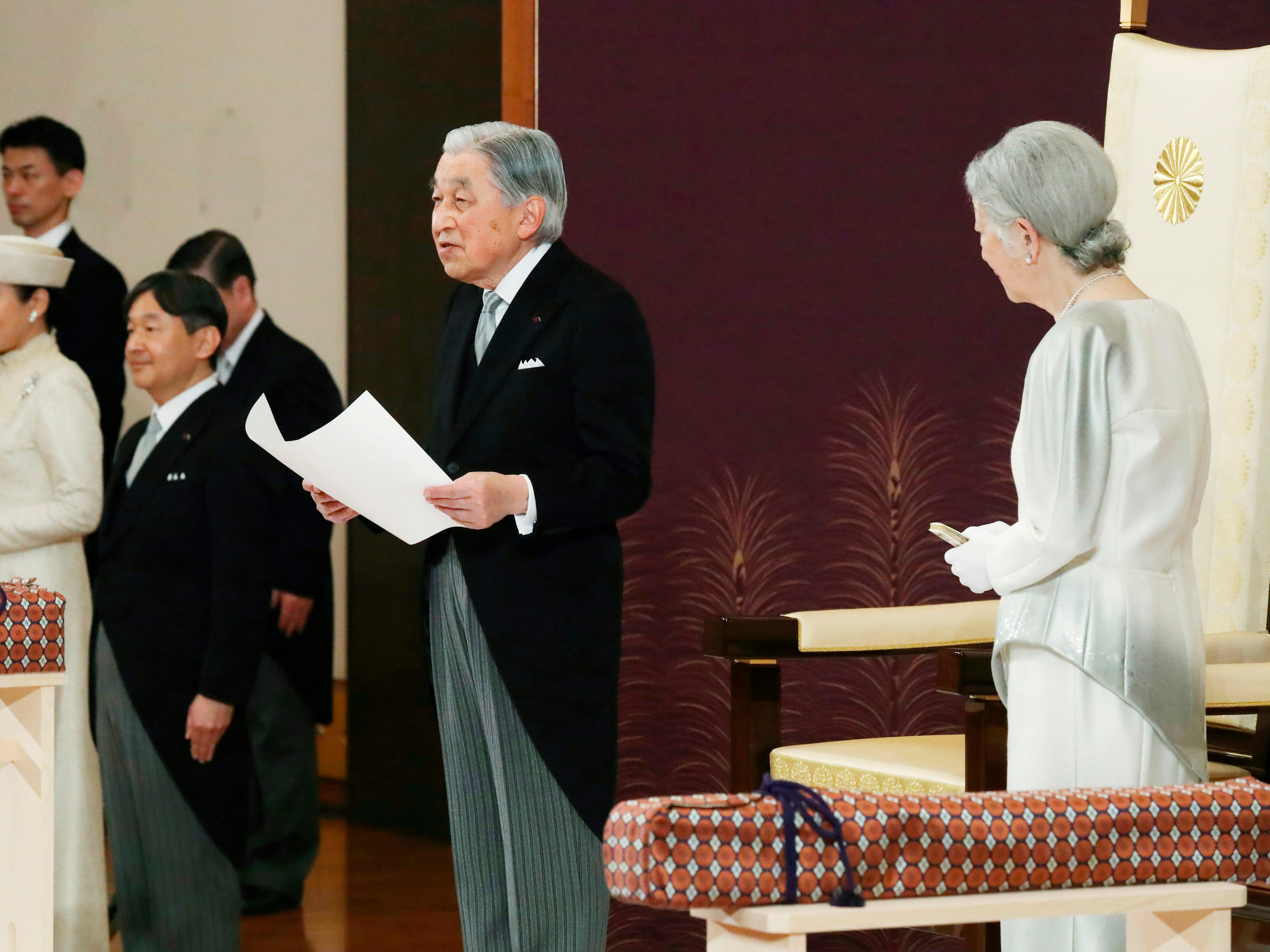 Japan's Emperor Akihitoa addresses the ceremony of his abdication in front of other members of the royal families and top government officials at the Imperial Palace in Tokyo, Tuesday, April 30, 2019. The 85-year-old ends his three-decade reign on Tuesday as his son Crown Prince Naruhito, second from left, will ascend the Chrysanthemum throne on Wednesday. Empress Michiko is at right and Crown Princess Masako is at left.