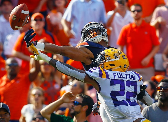 LSU cornerback Kristian Fulton (22) breaks up a pass in the end zone intended for Auburn wide receiver Darius Slayton during a game last season.