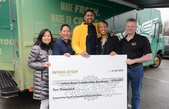 Wingstop Charities and local brand partners present Jalen Rose with a $10,000 grant to the Jalen Rose Leadership Academy on Monday.