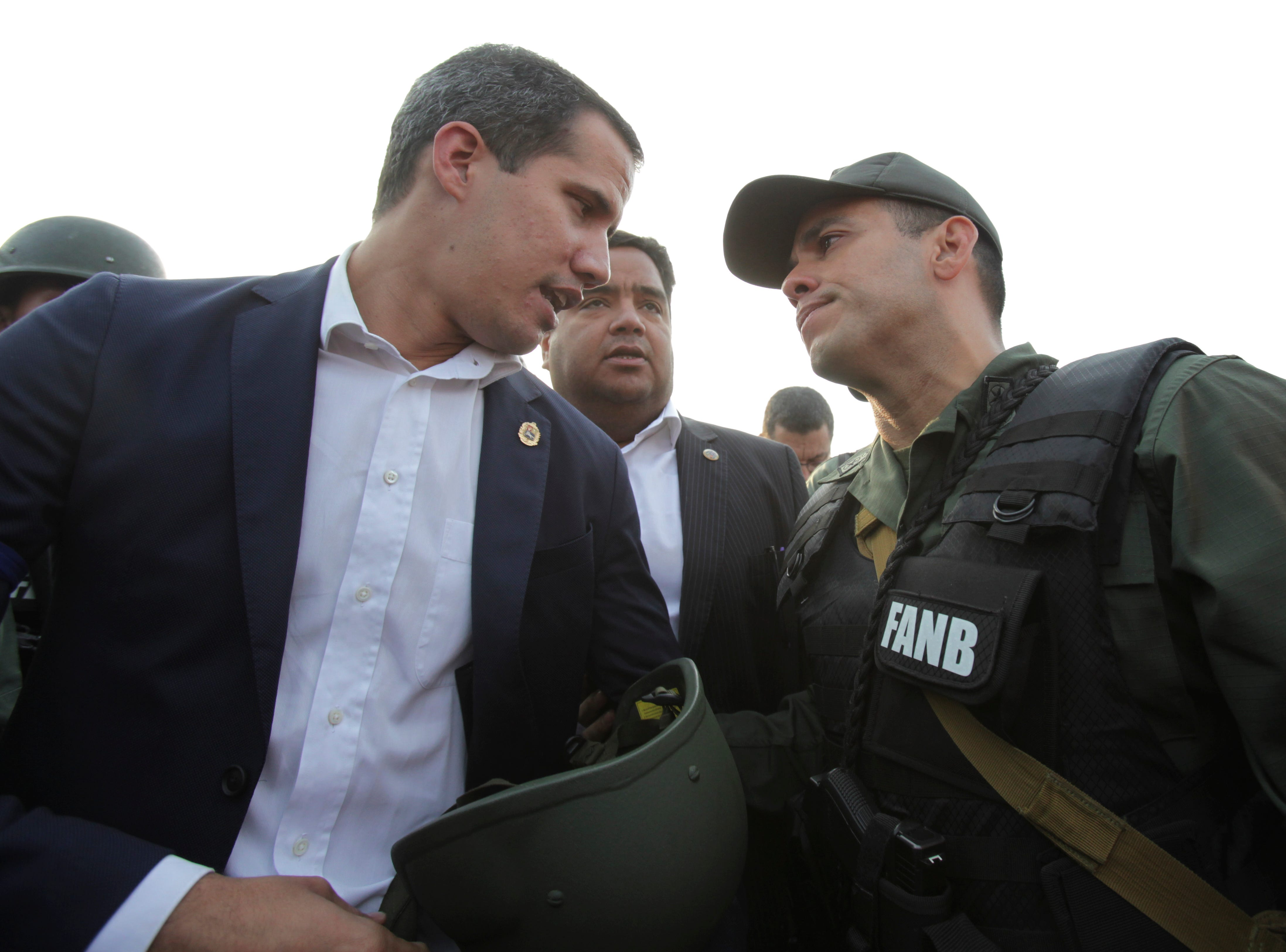 Venezuela's opposition leader and self proclaimed president Juan Guaido talks to an Army officer outside La Carlota air base in Caracas, Venezuela, Tuesday, April 30, 2019. Guaido took to the streets with a small contingent of armed soldiers and detained activist Leopoldo Lopez calling for a military uprising.