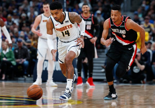 Denver Nuggets guard Gary Harris (Michigan State) pursues the ball with Portland guard CJ McCollum in the first half Monday.