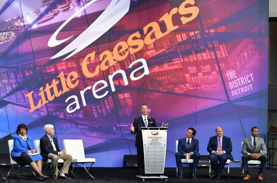 FILE - Chris Ilitch speaks during the ribbon cutting ceremony for Little Caesars Arena in Detroit on Sept. 5, 2017.