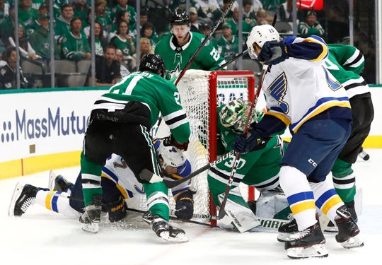 The puck flies into the net as Dallas' Ben Lovejoy (21) and Ben Bishop defend against pressure from St. Louis' Pat Maroon (7) and Robert Thomas.
