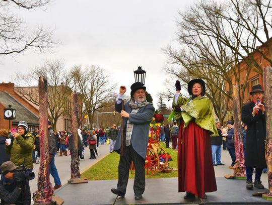 """Actors portraying characters from Charles Dickens' """"A Christmas Carol"""" perform during downtown Wellsboro's 2016 Dickens of a Christmas."""