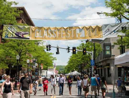 Visitors walk down Corning's Market Street during the 2016 GlassFest celebration.