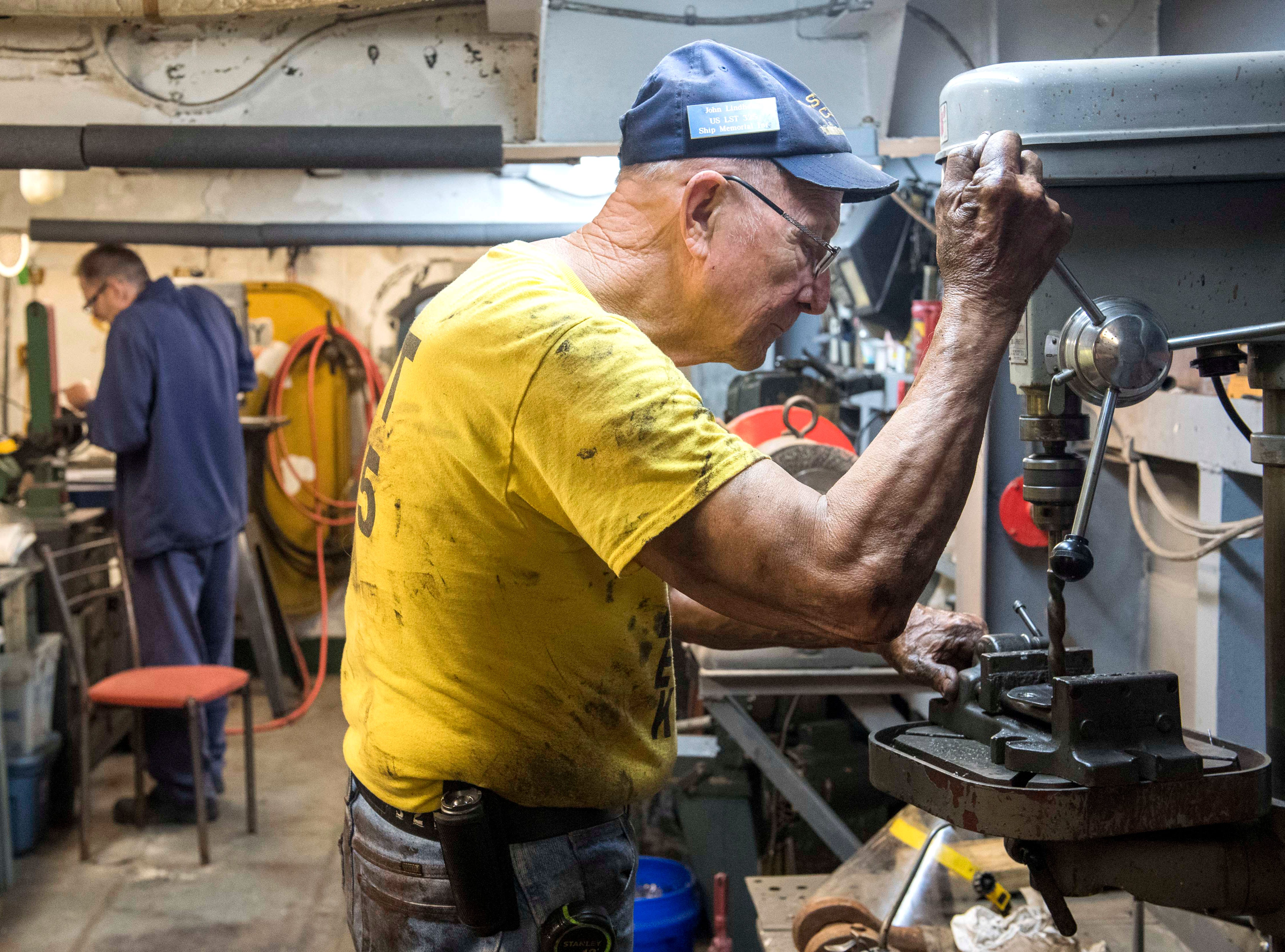 """USS LST Memorial volunteer John Lindholm, a 76-year-old Navy Veteran from Olney, Ill., manufactures a block-off plate for a valve in the machine shop of the LST 325 during """"Work Week"""" Tuesday, April 30, 2019. Volunteers from across the nation will spend the week completing multiple tasks to ready the 76-year-old ship for the summer tourist and cruising season."""