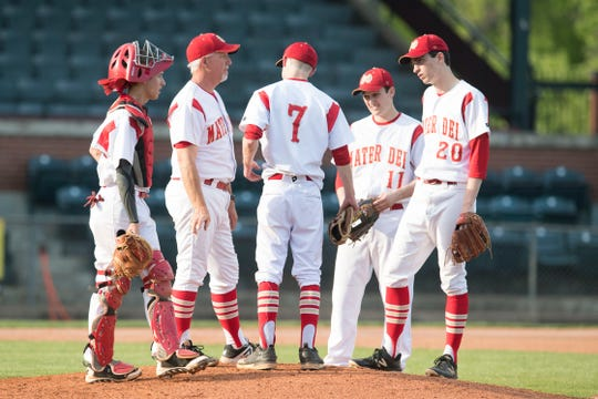 The Mater Dei Wildcats meet at the mound during the Mater Dei Wildcats vs Southridge Raiders baseball game at Bosse Field Monday, April 29, 2019.