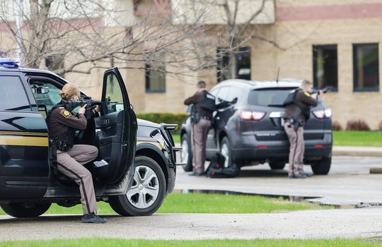 Fond du Lac County Sheriff's deputies surround a building Tuesday, April 30, 2019, at 33 East Larsen Drive in Fond du Lac. Authorities arrested a man wanted in a drug investigation after he ran into a local business after a short police pursuit.