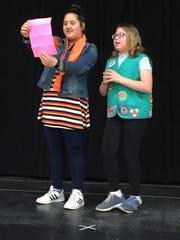 "Edwina (Brooklyn Bosch) and Girl Scout Annie (Hannah Hartigan) practice for the St. Boniface Catholic School presentation of ""Dear Edwina Jr."""