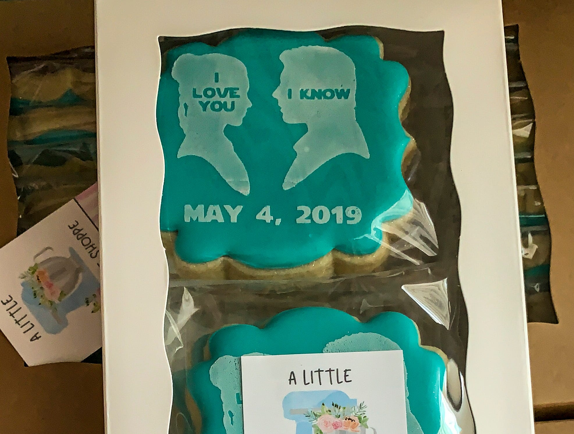 """Amanda Arrington operates """"A Little Cookie Shoppe"""" from her home near the village of Estero.  She bakes and decorates unique, custom cookies for different occasions. She's also a mom with six kids. April 30, 2019. Cookies for a wedding on May 4th to give as favors."""