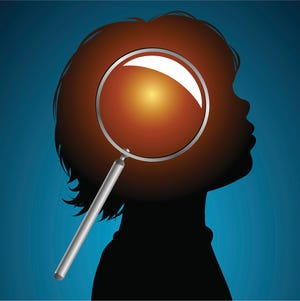Young child's mind under a magnifying glass.