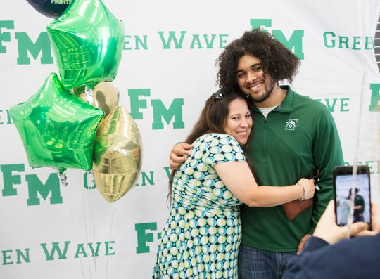 Fort Myers High School signee Malachi Jimenez, football at Stetson hugs his mother, Julie Starr  during a signing party at the school on Tuesday 4/30/2019.
