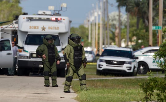 Members of the LCSO bomb squad inspect the area surrounding a house in a Cape Coral neighborhood after reports of a bomb threat Tuesday, April 30, 2019.