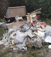 A Lehigh Acres man is facing charges of  dumping litter after a pile of trash weighing more than 500 pounds was found along a Lee County street.