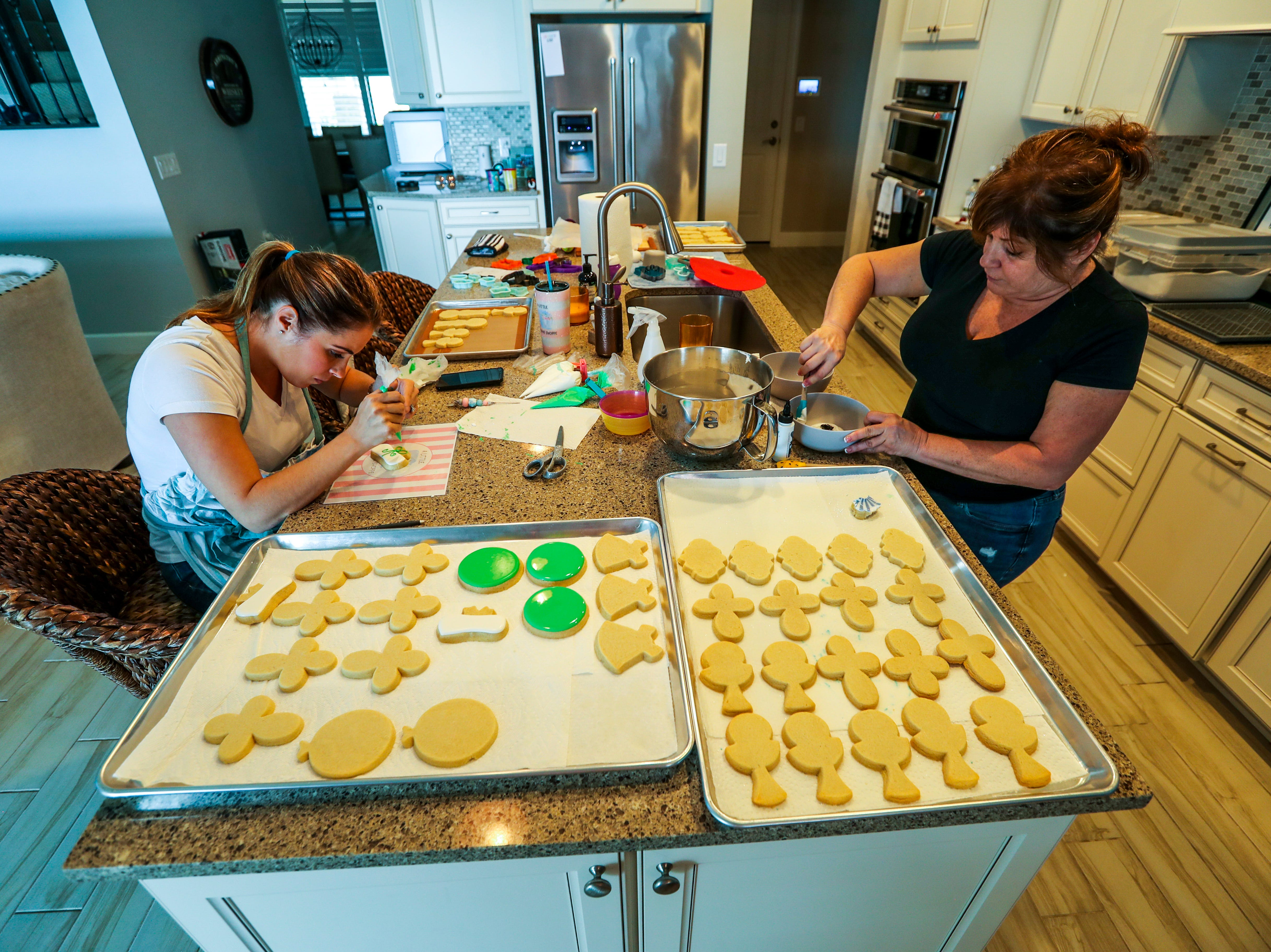 """Amanda Arrington operates """"A Little Cookie Shoppe"""" from her home near the village of Estero.  She bakes and decorates unique, custom cookies for different occasions. She's also a mom with six kids. April 30, 2019. She gets help from her mother during the busy weeks. Her mom helps with the cookies and the kids. But Amanda still does all of the decorating."""