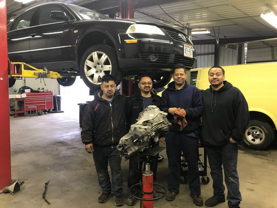 Jose Yanez (second from the left), owner of Yanez Auto Service in Green Bay, plans to close his shop Wednesday for the Day Without Latinxs & Immigrants protest in Madison. Pictured with Yanez are, from left, his son Gerardo; employee Jorge Silvan, and Yanez's son Omar.