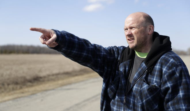 Project manager Mike Troge points to the boundary of the 32-acre field where the Oneida Nation plans to grow hemp this season.